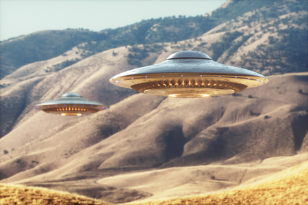 Two unidentified flying objects - UFO, flying over the sunny desert.