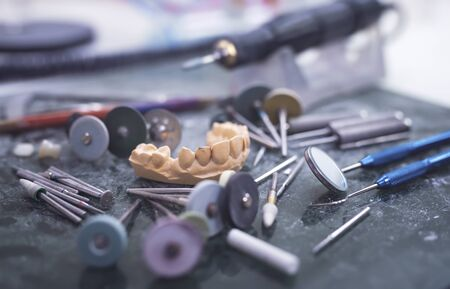 Artificial tooth being done by a dental prosthesis specialist.