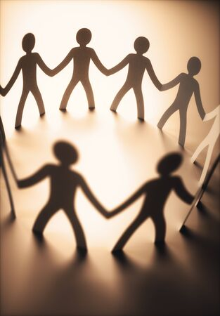 Group of people, united in the meeting of an organization. Paper cut out in the shape of people.