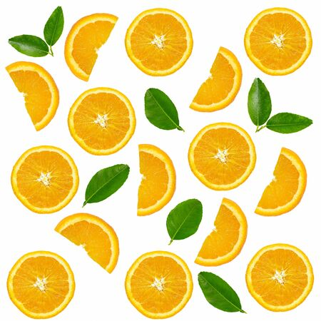 Orange fruit slices with leaves pattern on white background.