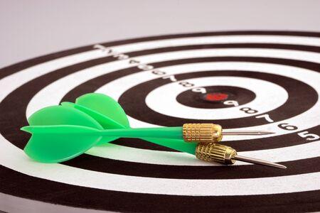 Green darts on the dart board. 版權商用圖片
