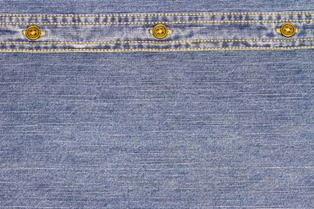 Fabric of Jeans denim with stud texture background.