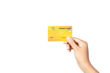Hand holding credit card isolated on white background. Imagens