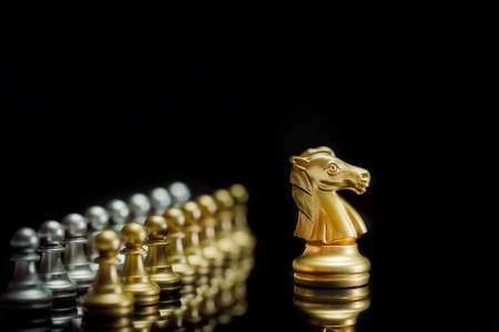 Golden chess knight pieces playing game and strategy. Concept of leadership and success