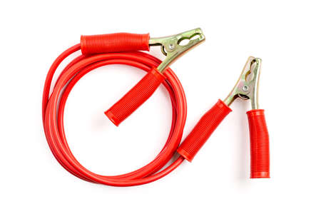 Red color battery extension cable or booster cable isolated on white background.