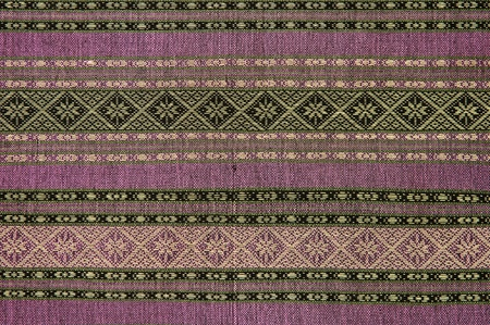 Hand-woven fabrics in Thai-pattern designs photo