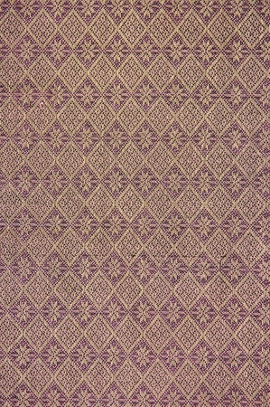 Hand-woven fabrics in Thai-pattern designs. photo
