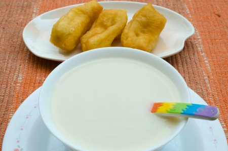 Soybean milk with deep-fried dough stick China delicious food  photo