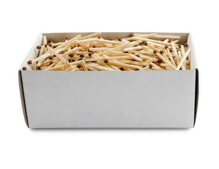 Big open cardboard box filled with matches isolated on white background