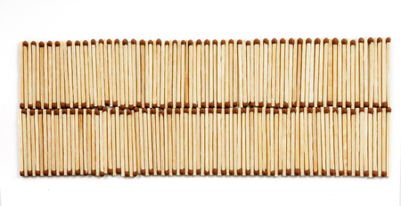 Two rows of many matches isolated on white background view from above Imagens