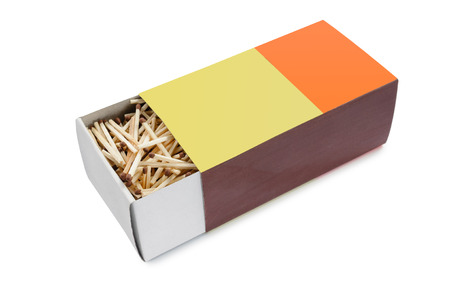Big half open matchbox filled with matches isolated on white background