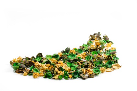 Pile of content from aromatic sachet of dried parts of spicy herbs isolated on white background side view from above
