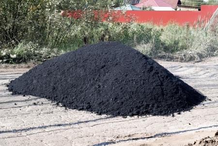 admixture: Highway repair. Heap of fresh asphalt