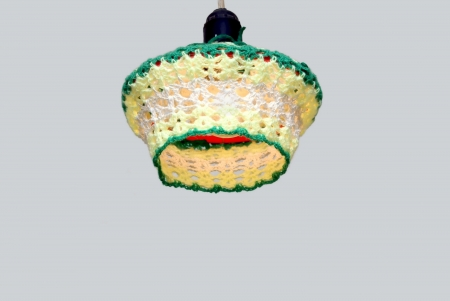 Knitted lampshade for electric light bulbs Stock Photo - 15522233