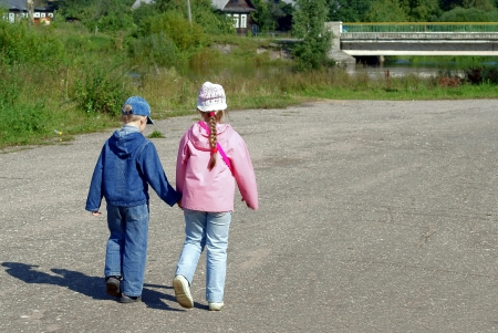 Children go on road, having joined hands photo
