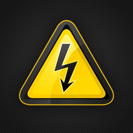 metal surface: Hazard warning triangle high voltage sign on a metal surface