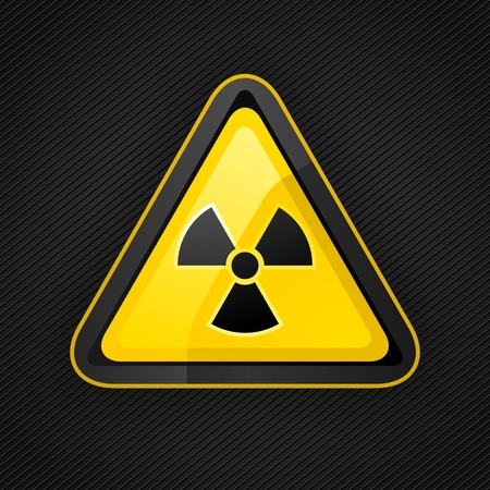 Hazard warning triangle radioactive sign on a metal surface Stock Vector - 12178525