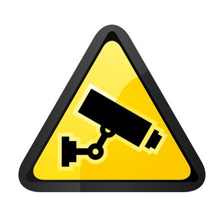 Black surveillance camera on a yellow triangular shape