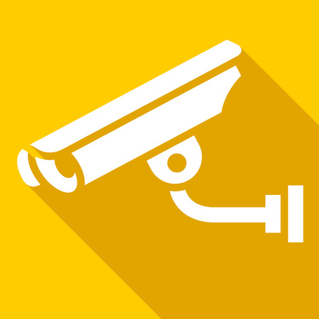 White surveillance camera on a yellow square
