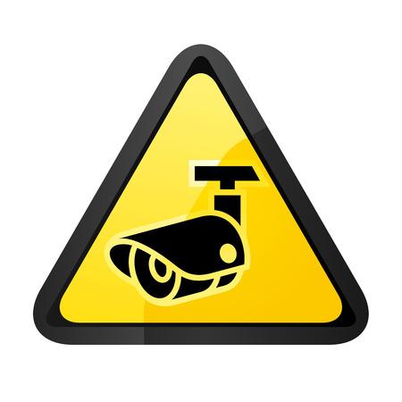 Caméra de surveillance noire sur une forme triangulaire jaune