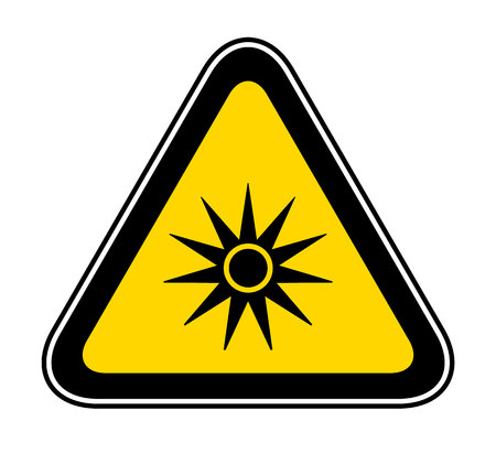 Triangular yellow Warning Hazard Symbol with sun