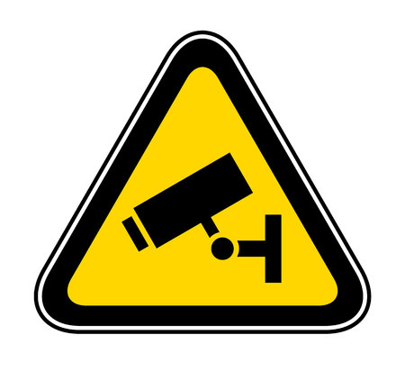 Triangular yellow Warning Hazard Symbol for cctv camera