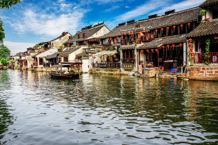 zhouzhuang: XITANG, CHINA - SEP 16: Traveler at Xitang ancient town on Sep 16, 2013 , Xitang is first batch of Chinese historical and cultural town, located in Zhejiang Province, China. Editorial