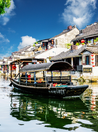 house float on water: XITANG, CHINA - SEP 16: Traveler at Xitang ancient town on Sep 16, 2013 , Xitang is first batch of Chinese historical and cultural town, located in Zhejiang Province, China. Editorial