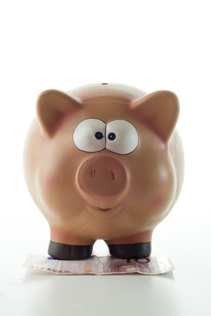 Piggy moneybox on white background photo