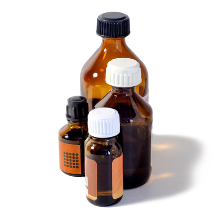 healthcare facility: four medical bottles brown glass