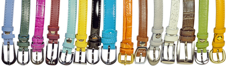 convolute: new multi-colored leather fashion belts are on the table isolated on white background
