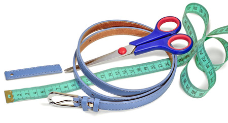 sartorial: waist belt, scissors, sartorial ruler and part of the belt, isolated on white background