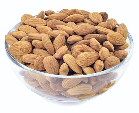 dry cleaned: peeled nuts almonds in glass bowl isolated on white background
