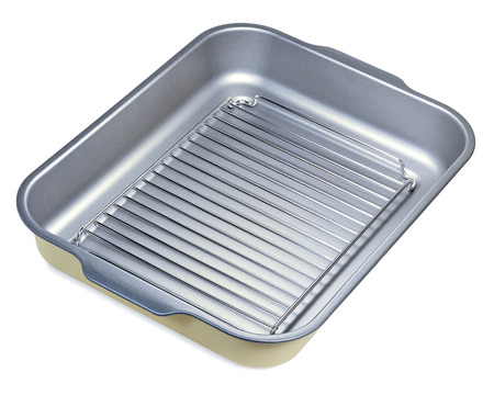 metal grate: A metal baking tray with a grate and stainless steel with grey non-stick coating isolated on white Stock Photo