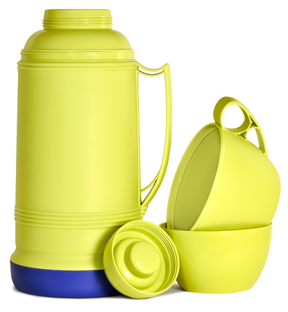 insulated drink container: Green plastic thermos mug and lid on a white background Stock Photo