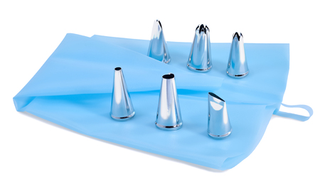 metal tips: silicone pastry bag blue color and metal tips for decorating cakes, isolated on white background Stock Photo