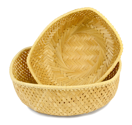 two wicker baskets from the straw material is light yellow small and large with a view of the front, isolated on white background