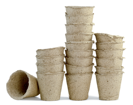 dirt: a lot of cups of peat for seedlings of plants inserted into one another and are installed in a row isolated on white background