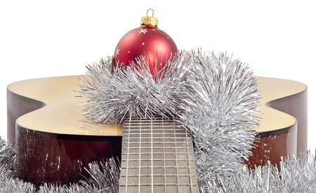 closeup of Christmas decorations in Christmas decorations red ball, shiny tinsel lay in the center of the guitar brown