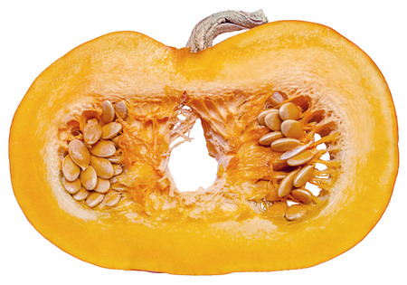 Part of a small orange pumpkin in a cut isolated on a white background close-up.
