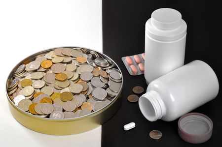 The image of the concept of social injustice, collapse, comparing the standard of living in the form of a tin can with a lot of metal coins on a white background and drugs and little money on a black background. Archivio Fotografico