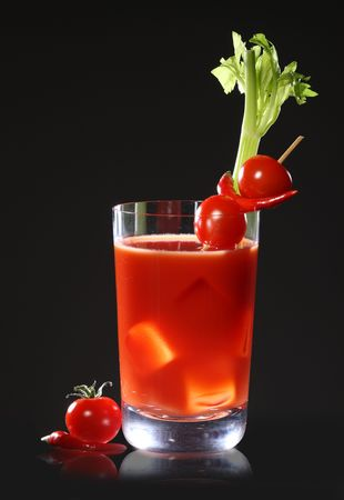 Bloody Mary or tomato juices on black background