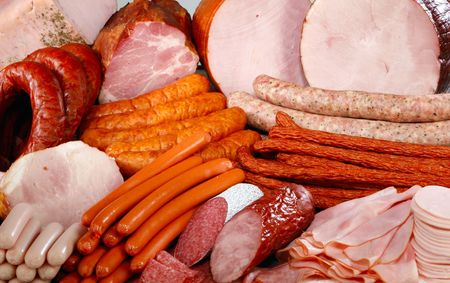 cured: Cutting sausage and meat on a celebratory table.  Stock Photo