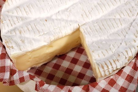 Camembert cheese on a red checkered napkin Stock Photo