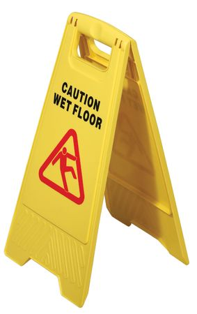 Yellow floor sign with words