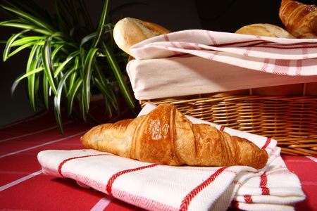 Baked goods.  Croissant on white - red tablecloth close up Stock Photo