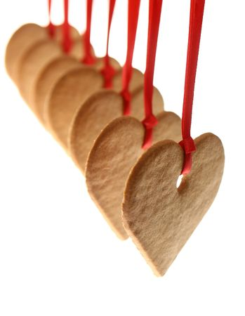Gingerbread hearts and red bow isolated on white background  photo