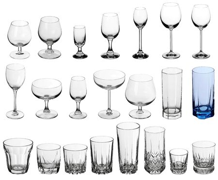 Set of glasses for alcoholic drinks on white
