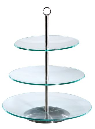 Glass three - level cake stand. Isolated on white