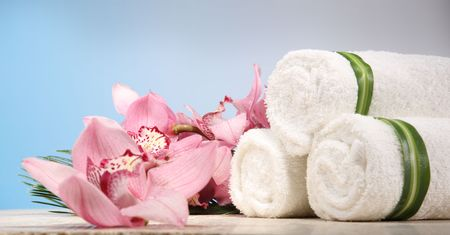 Fresh Orchid and Towel in Spa Display  Stock Photo